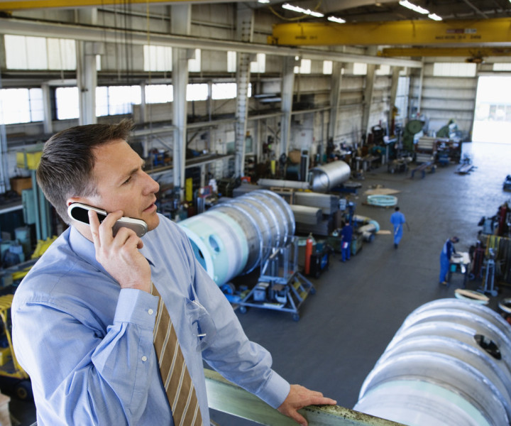 Man using phone in a factory