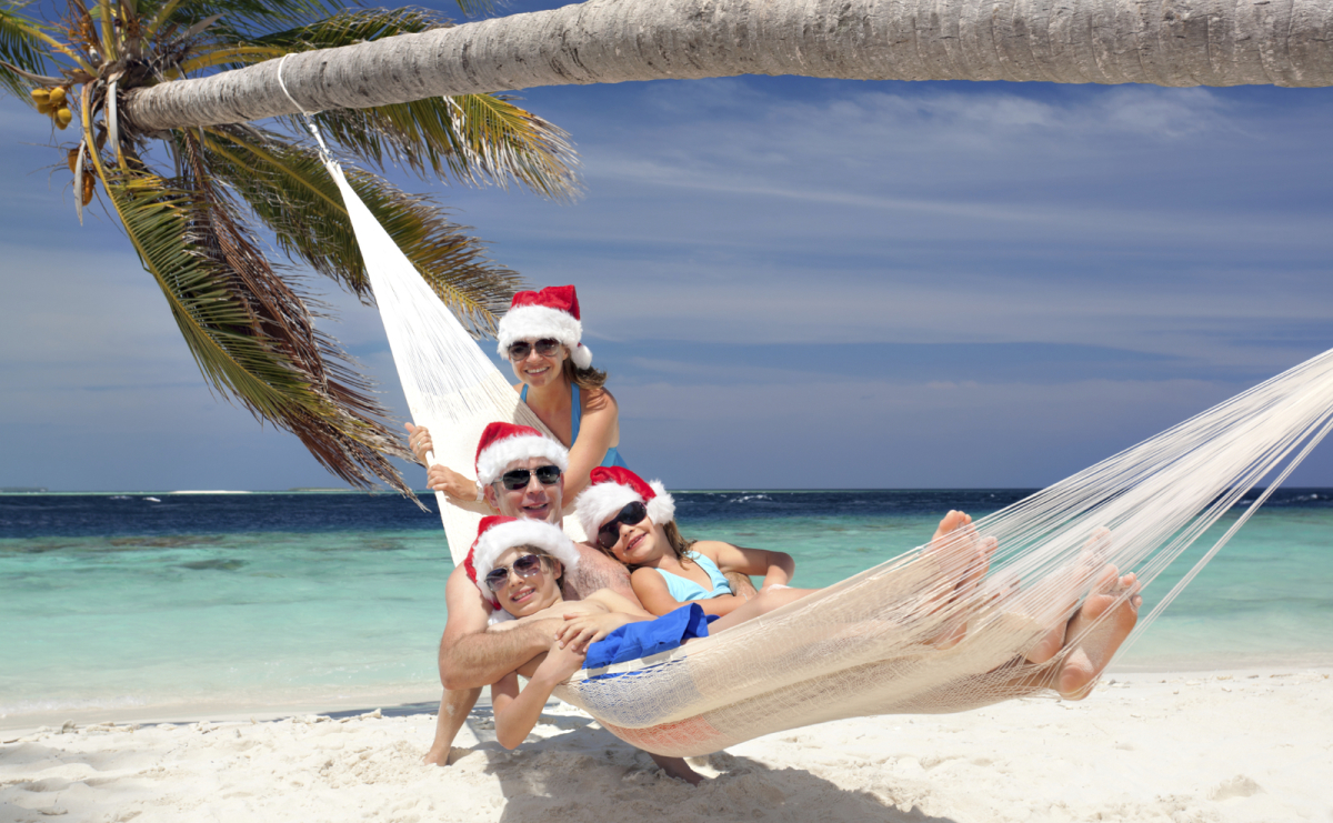 Family in a hammock on a tropical beach