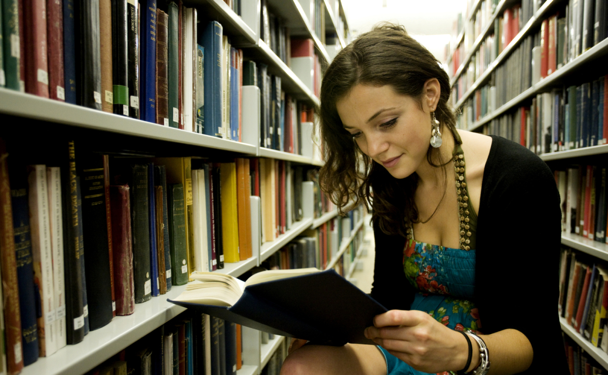 Girl studying in  a library