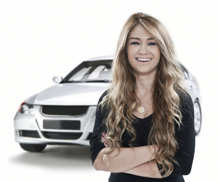 Smiling woman in front of a car