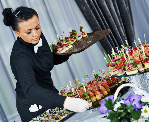 Waitress setting up a buffet