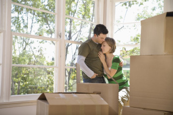 Couple in a new home with boxes