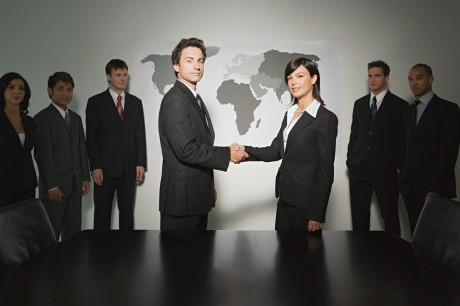 Business meeting; principles shaking hands
