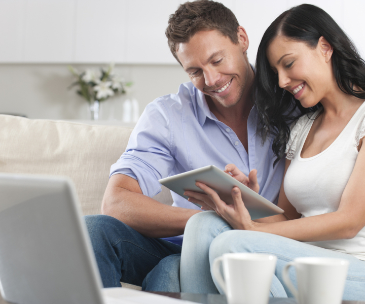 Couple browsing the web on  a tablet computer