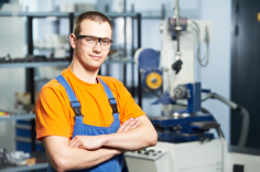 worker in front of some machinery