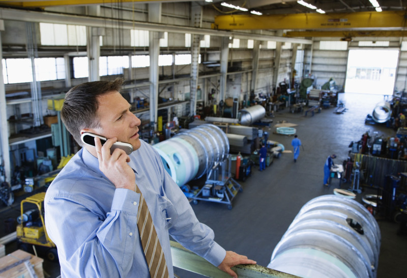 Manager on the phone in a factory